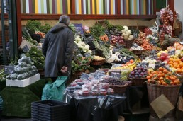 A shopper browses at a food market, in London