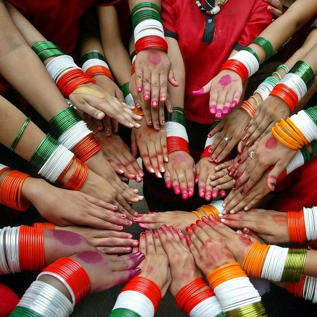Indian children display their bangles, painted with the colours of the Indian national flag