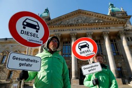 Greenpeace climate change activists demonstrate in favour of cities banning diesel cars to help reduce air pollution, in Leipzig, Germany, February 27, 2018. The placards read: