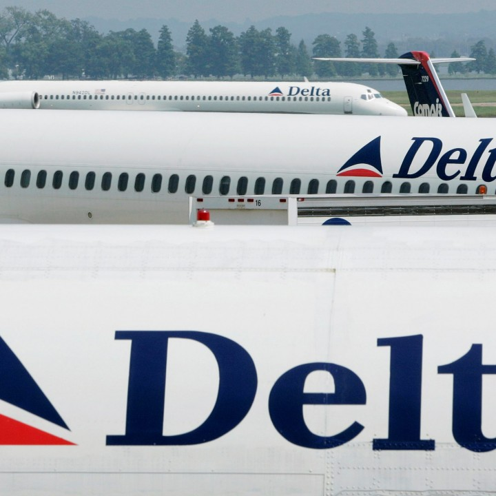 Delta Airlines jets sit at the terminal at Reagan National Airport outside Washington in this August 19, 2004. REUTERS/Larry Downing