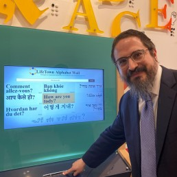 Co-founder and CEO of LifeTown Rabbi Zalman Grossbaum poses for a photo in front of an Alphabet Wall in LifeTown, a 53,000-square-foot center dedicated to teaching life skills to children and adults with special needs, in Livingston, New Jersey, U.S. March 2, 2020. REUTERS/Roselle Chen