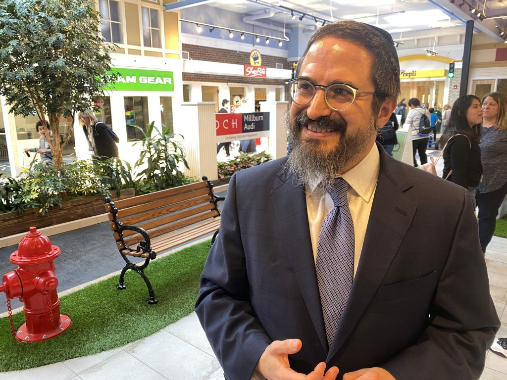 Co-founder and CEO of LifeTown Rabbi Zalman Grossbaum reacts in LifeTown Shoppes, an indoor Main Street with businesses that allows for students with special needs to practice how to interact in real-world settings, in Livingston, New Jersey, U.S. March 2, 2020. REUTERS/Roselle Chen