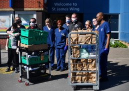 REFILE - CORRECTING NAME OF HOSPITAL Nurses and staff carry food delivered by volunteers outside St George's Hospital as the spread of the coronavirus disease (COVID-19) continues, in London, Britain, March 23, 2020. REUTERS/Dylan Martinez