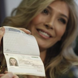 Attorney Gloria Allred (not pictured) holds the passport of Canadian transgender model Jenna Talackova during a news conference in Los Angeles, California April 3, 2012. REUTERS/Mario Anzuoni