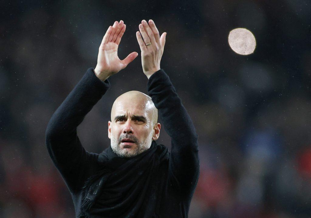 Soccer Football - Premier League - Manchester United v Manchester City - Old Trafford, Manchester, Britain - March 8, 2020. Manchester City manager Pep Guardiola applauds the fans after the match. Action Images via Reuters/Carl Recine.