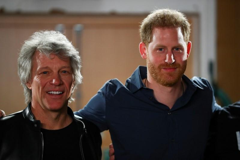 Britain's Prince Harry and Jon Bon Jovi pose for a picture with choir members during a visit at Abbey Road Studios in London, Britain February 28, 2020. REUTERS/Hannah McKay/Pool/
