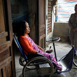 Hoang Thi Hoa (L), who lost both legs and an arm due to unexploded ordnance (UXO) during the Vietnam War, and her daughter Nguyen Thi Ha Lan, a member of all-female landmines clearance team, talk at their house in Quang Tri province, Vietnam March 4, 2020. Picture taken March 4, 2020. REUTERS/Kham