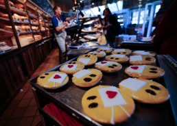 Cakes that look like emojis with protective masks are seen at a bakery, as the spread of the coronavirus disease (COVID-19) continues in Dortmund, Germany, March 26, 2020. REUTERS/Leon Kuegeler
