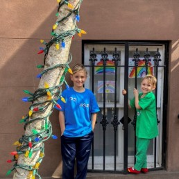 "Whit, 8 and Colton, 6, display pictures they drew in their home ""art class"" as part of the Quarantine Rainbow Project in Brooklyn, New York, March 18, 2020. Picture taken March 18, 2020. REUTERS/Lauren Young"