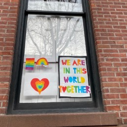 Pictures drawn by children as part of the Quarantine Rainbow Project in Brooklyn, New York, March 18, 2020. REUTERS/Lauren Young