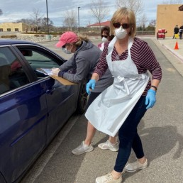 Volunteers hand out free groceries at a drive-by aid station providing food, lunches and breakfasts to families and children during the global rise of coronavirus disease (COVID-19) cases, at Enos Garcia Elementary School in Taos, New Mexico, U.S. March 18, 2020. REUTERS/Andrew Hay