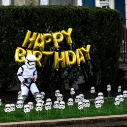 Reuben Goodman dressed as Star War Trooper dances outside of his house on his 5th birthday party during the outbreak of the coronavirus disease (COVID-19) in South Orange, New Jersey U.S., April 14, 2020. REUTERS/Eduardo Munoz