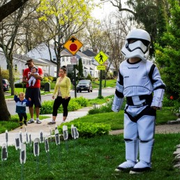 Reuben Goodman dressed as Star War Trooper dances outside of his house on his 5th birthday party as some neighbours greets him during the outbreak of the coronavirus disease (COVID-19) in South Orange, New Jersey U.S., April 14, 2020. REUTERS/Eduardo Munoz