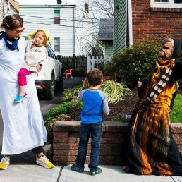 Neighbours dressed up in Star War customs dances outside of Reuben Goodman house during his 5th birthday party as the outbreak of the coronavirus disease (COVID-19) continues in South Orange, New Jersey U.S., April 14, 2020. REUTERS/Eduardo Munoz