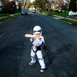 Reuben Goodman poses for a picture during his 5th birthday party in an empty street as the outbreak of the coronavirus disease (COVID-19) continues in South Orange, New Jersey U.S., April 14, 2020. REUTERS/Eduardo Munoz