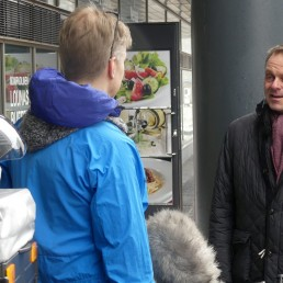 Violinist Teppo Ali-Mattila talks to Helsinki Mayor Jan Vapaavuori as he delivers food to vulnerable residents during the coronavirus disease (COVID-19) outbreak, in Helsinki, Finland April 16, 2020. Picture taken April 16, 2020. REUTERS/Attila Cser