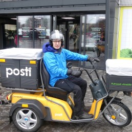 Violinist Teppo Ali-Mattila drives an electric bike as he delivers food to vulnerable residents during the coronavirus disease (COVID-19) outbreak, in Helsinki, Finland April 16, 2020. Picture taken April 16, 2020. REUTERS/Attila Cser