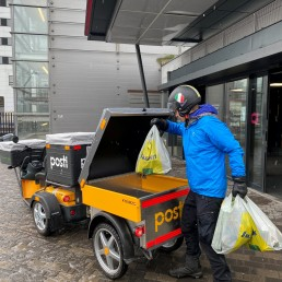 Violinist Teppo Ali-Mattila delivers food to vulnerable residents during the coronavirus disease (COVID-19) outbreak, in Helsinki, Finland April 16, 2020. Picture taken April 16, 2020. REUTERS/Attila Cser