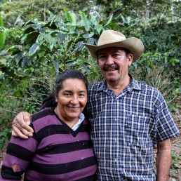 Arcadio Barajas and his wife Marta Moreno pose for a photo in the middle of a coffee plantation in San Lucas, Colombia February 26, 2020. Picture taken February 26, 2020. REUTERS/Oliver Griffin