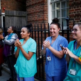 NHS workers applaud at St Mary's hospital during the Clap for our Carers campaign in support of the NHS, as the spread of the coronavirus disease (COVID-19) continues, in London, Britain, April 23, 2020. REUTERS/Henry Nicholls