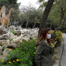 Zoo staff members, Ines Catela and Jose Dias, accompany Reuters journalists during a visit at the Lisbon Zoo as the spread of the coronavirus disease (COVID-19) continues, in Lisbon, Portugal April 23, 2020. REUTERS/Rafael Marchante