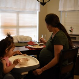 Pregnant nurse Samantha Salinas eats alongside her daughter, Macie, amid a coronavirus disease (COVID-19) outbreak in San Antonio, Texas, U.S., May 6, 2020. REUTERS/Callaghan O'Hare