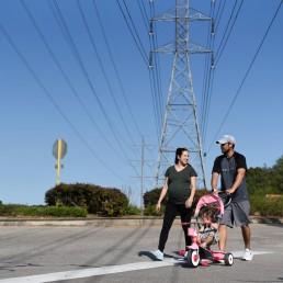 Pregnant nurse Samantha Salinas takes a walk with her husband, Tim, and their daughter, Macie, amid a coronavirus disease (COVID-19) outbreak in San Antonio, Texas, U.S., May 6, 2020. REUTERS/Callaghan O'Hare