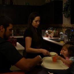 Pregnant nurse Samantha Salinas and her husband, Tim, feed their daughter, Macie, amid a coronavirus disease (COVID-19) outbreak in San Antonio, Texas, U.S., May 7, 2020. REUTERS/Callaghan O'Hare