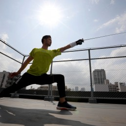 Japan's Olympic fencing medallist Ryo Miyake trains at the rooftop of his apartment under a nationwide state of emergency as the spread of the coronavirus disease (COVID-19) continues in Tokyo, Japan May 12, 2020. REUTERS/Issei Kato