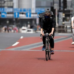 Japan's Olympic fencing medallist Ryo Miyake cycles as he works his part-time job as Uber Eats delivery person under a nationwide state of emergency as the spread of the coronavirus disease (COVID-19) continues in Tokyo, Japan May 12, 2020. Picture taken May 12, 2020. REUTERS/Issei Kato
