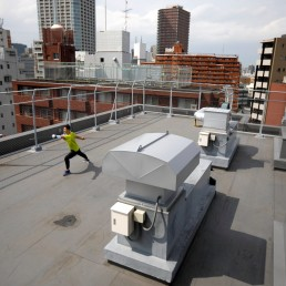 Japan's Olympic fencing medallist Ryo Miyake trains at the rooftop of his apartment under a nationwide state of emergency as the spread of the coronavirus disease (COVID-19) continues in Tokyo, Japan May 12, 2020. Picture taken May 12, 2020. REUTERS/Issei Kato