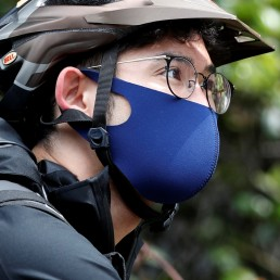 Japan's Olympic fencing medallist Ryo Miyake wearing a protective face mask works his part-time job as Uber Eats delivery person under a nationwide state of emergency as the spread of the coronavirus disease (COVID-19) continues in Tokyo, Japan May 12, 2020. Picture taken May 12, 2020. REUTERS/Issei Kato