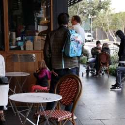 Customers sit at a cafe on the first morning of eased coronavirus disease (COVID-19) restrictions, allowing up to 10 patrons to sit at a time inside establishments previously only opened for take-away, in Sydney, New South Wales, Australia, May 15, 2020. REUTERS/Loren Elliott
