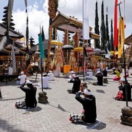 Balinese Hindus pray as they encourage social distancing during a ritual amid coronavirus disease (COVID-19) outbreak, at Ulun Danu Batur temple in Kintamani, Bali, Indonesia, April 7, 2020. REUTERS/Johannes P. Christo