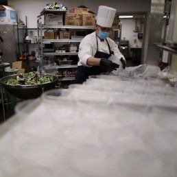 A chef prepares salad at the Westin Bonaventure hotel as part of California Governor Gavin Newsom's program to use FEMA and local money to produce meals to deliver to at-risk seniors, as the global outbreak of the coronavirus disease (COVID-19) continues, in Los Angeles, California, U.S., May 7, 2020. REUTERS/Lucy Nicholson