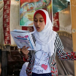 A Palestinian school girl Fajr Hmaid, 13, teaches her neighbours' children an Arabic language lesson, as schools are shut due to the coronavirus disease (COVID-19) restrictions, at her family house in Gaza, May 19, 2020. REUTERS/Mohammed Salem