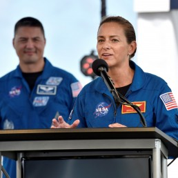 Astronaut Nicole Mann talks to the media, as fellow astronaut Kjell Lindgren looks on, during a prelaunch briefing before the launch of the SpaceX Crew Dragon spacecraft on a Falcon 9 booster rocket from Pad39A at the Kennedy Space Center in Cape Canaveral, Florida, U.S., May 29, 2020. REUTERS/Steve Nesius