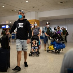 Passengers of a flight from Amsterdam wearing protective face masks arrive at the Eleftherios Venizelos International Airport, following the easing of measures against the spread of coronavirus disease (COVID-19), in Athens, Greece, June 15, 2020. REUTERS/Alkis Konstantinidis
