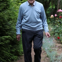 103-year-old Belgian oldest former general practitioner Alfons Leempoels walks in his garden intending to cover a distance equivalent of a marathon to raise money for scientists researching the coronavirus disease (COVID-19) in Rotselaar, Belgium June 9, 2020. REUTERS/Yves Herman
