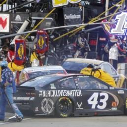 Jun 10, 2020; Martinsville, VA, USA; NASCAR driver Bubba Wallace (43) makes a pit stop during the NASCAR Cup Series at Martinsville at Martinsville Speedway. Mandatory Credit: Steve Helber/Pool Photo via USA TODAY Network