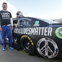 Jun 10, 2020; Martinsville, VA, USA; NASCAR driver Bubba Wallace waits for the start of the NASCAR Cup Series at Martinsville at Martinsville Speedway. Mandatory Credit: Steve Helber/Pool Photo via USA TODAY Network