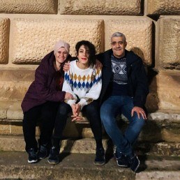L-R Ghada Zitouni, Riham Alkousaa and Isam Alkousaa pose for a picture at Alhambra Palace in Granada, Spain, December 13, 2019. Picture taken December 13, 2019. REUTERS/Maram Alkousaa