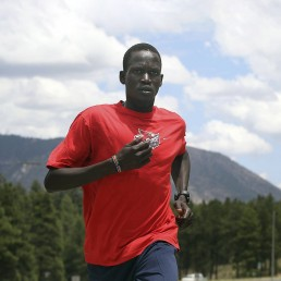 Guor Marial, 28, runs along a street in Flagstaff, Arizona July 21, 2012. The marathon runner born in what is now South Sudan will be allowed to run under the Olympic flag in London, the International Olympic Committee said on Saturday. As a 16-year-old Marial moved to the U.S., where he has permanent resident status. Given South Sudan, the world's newest country recognised only last year, has not yet established a national Olympic Committee - and so cannot send a team to the Games starting next week - Marial was unable to represent that country. As he is not a U.S. citizen, he was also ineligible to take part for the Americans. REUTERS/Darryl Webb