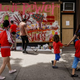 Artists paint a mural on a boarded-up storefront as part of neighborhood project in the Bowery neighborhood of Manhattan in New York City, New York, U.S., June 17, 2020. Picture taken June 17, 2020. REUTERS/Brendan McDermid