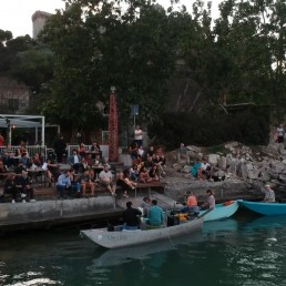 Blues musicians perform on small fishing boats on Lake Trasimeno to ensure social distancing during a concert that would usually be on a stage on land, after Italy eased more of its coronavirus disease (COVID-19) restrictions, in Lake Trasimeno, Italy, June 21, 2020. Picture taken June 21, 2020. REUTERS TV via REUTERS