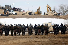Law enforcement officers advance into the main opposition camp against the Dakota Access oil pipeline near Cannon Ball, North Dakota, U.S., February 23, 2017. REUTERS/Terray Sylvester