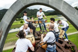 Internationally renowned percussionist Martin Grubinger combined classical music with sounds of motorsports, to create a musical opener to back-to-back grands prix in Spielberg: the Formula 1 Rolex Grosser Preis von Österreich on July 5 followed by the Formula 1 Pirelli Grosser Preis der Steiermark on July 12. Grubinger brought together musicians from different backgrounds and a 150-strong choir to make his vision a reality. At the heart of the musical installation known as 'Drum the Bull' was the steel Bull of Spielberg, which was brought to life by Grubinger and his fellow percussionists using brushes, metal and wooden drumsticks and even hammers. // The Percussive Planet Ensemble performs in Spielberg, Austria on June 21, 2020. // Joerg Mitter / Red Bull Content Pool