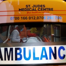 Medics examine a pregnant woman in an ambulance during the coronavirus night curfew in Nairobi, Kenya June 19, 2020. Picture taken June 19, 2020. REUTERS/Baz Ratner