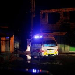 An ambulance drives to a pregnant woman during the coronavirus night curfew in Nairobi, Kenya June 19, 2020. Picture taken June 19, 2020. REUTERS/Baz Ratner