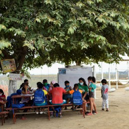 Denisse Toala (3rd R), a 16-year-old student, teaches children in an improvised school she has set up under a tree since they have been unable to attend virtual classes in the low-income neighbourhood Realidad de Dios, during the outbreak of the coronavirus disease (COVID-19), in Guayaquil, Ecuador July 2, 2020. REUTERS/Santiago Arcos